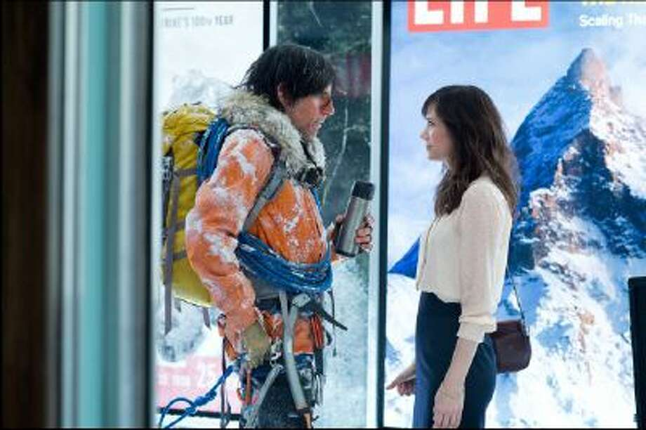 "Walter Mitty (Ben Stiller) imagines himself as a fearless mountain climber who captures the attention of his co-worker Cheryl (Kristen Wiig) in ""The Secret Life of Walter Mitty."""