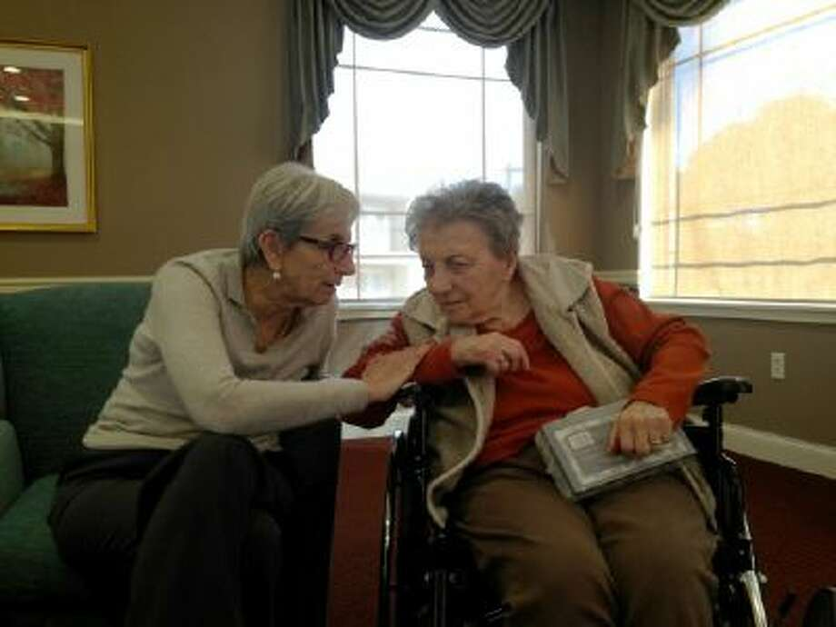 Andra Bucci, left, sits with Marth Weindling Friedmann, who cared for Bucci after World War II.