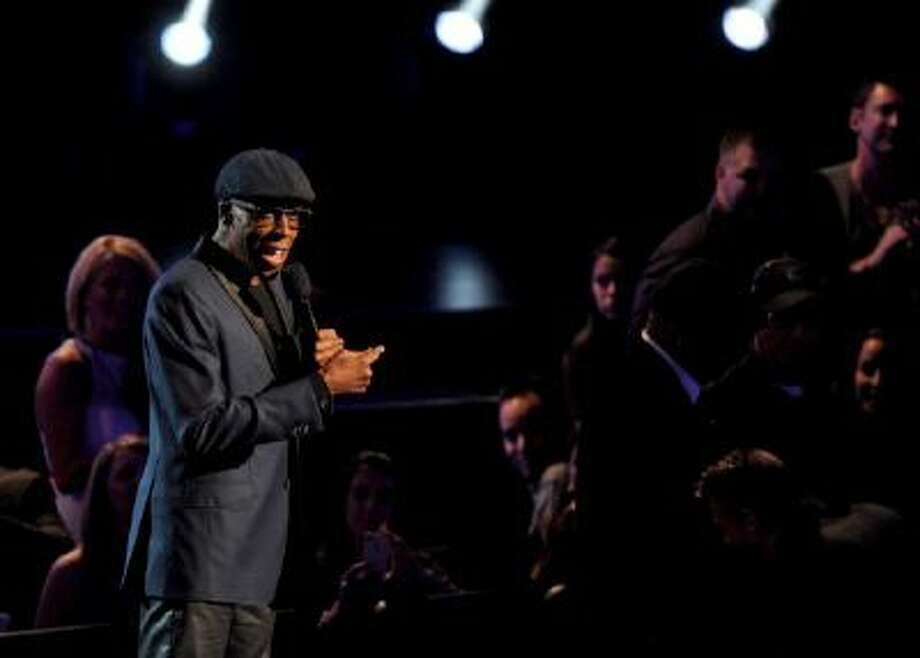 Arsenio Hall announces nominees for Best New Artist onstage at the Nominations Concert for the 56th Annual Grammy Awards, on Friday, Dec. 6, 2013 at Nokia Theatre L.A. Live in Los Angeles, Calif.