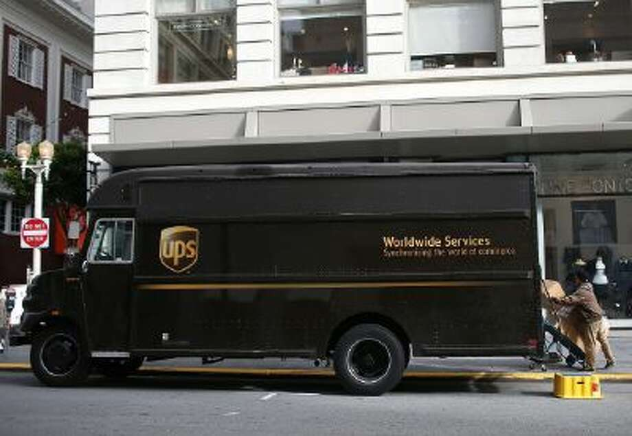 A UPS worker unloads packages from his truck on Dec. 20, 2012 in San Francisco.