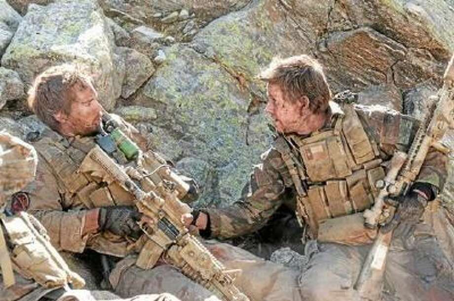 """Taylor Kitsch and Mark Wahlberg in """"Lone Survivor."""""""