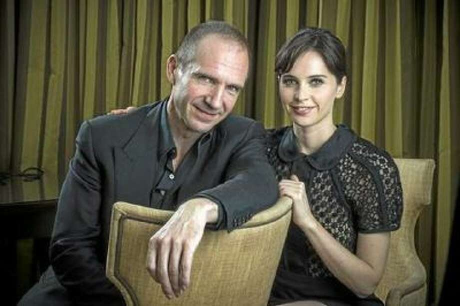 "Ralph Fiennes and Felicity Jones star in the new film, ""The Invisible Woman"", which is also directed by Fiennes, photographed in Beverly Hills on December 4, 2013. The film, which will be out Christmas Day, tells the story of author Charles Dickens and his secret lover."