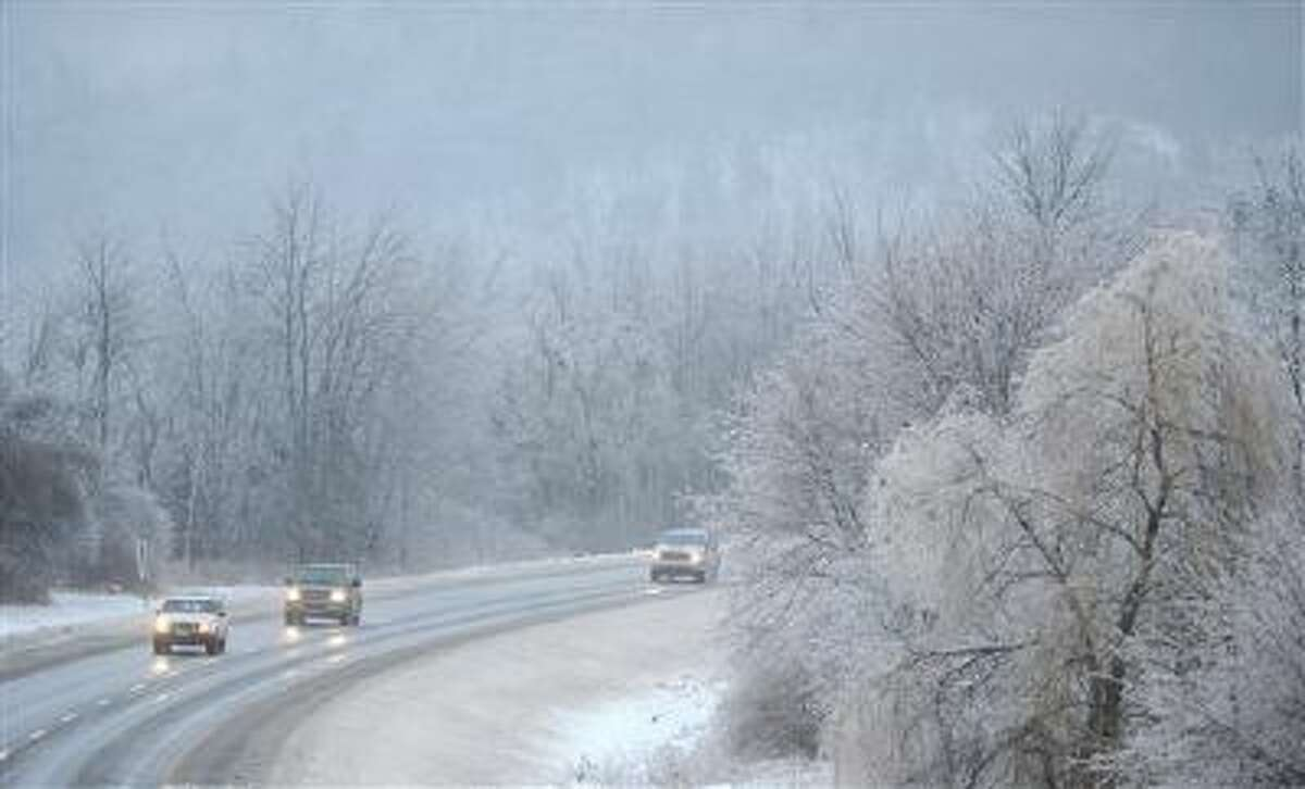 Traffic creeps down Interstate 95 in Waterville, Maine, on Monday. A cold storm is freezing much of the nation.