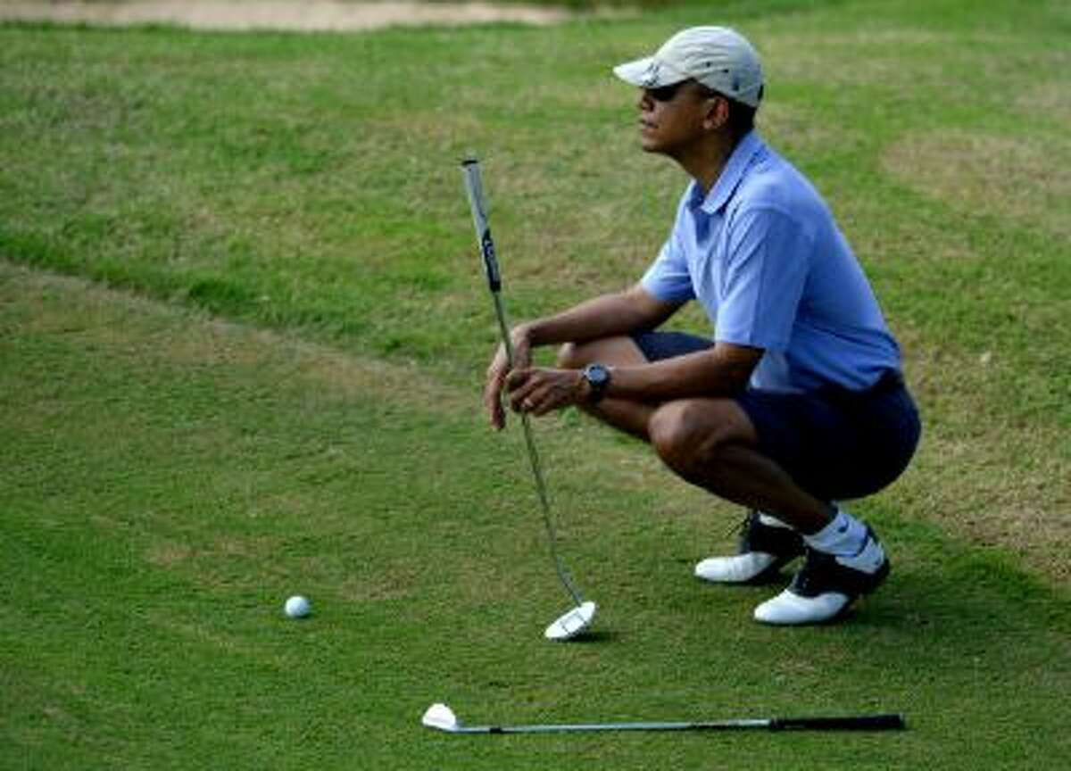 While golfing in Hawaii, Obama's aides signed him up for Obamacare to promote the law a day before the first enrollment deadline.