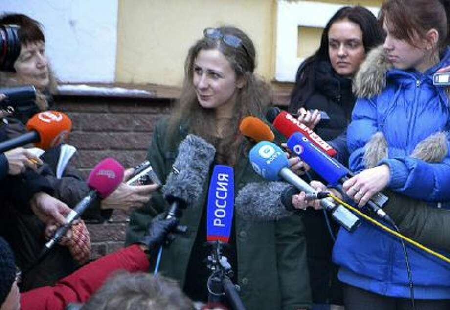 Maria Alekhina, second from left, a member of the Russian punk band Pussy Riot, speaks to the media after being released from prison on Monday, Dec. 23.