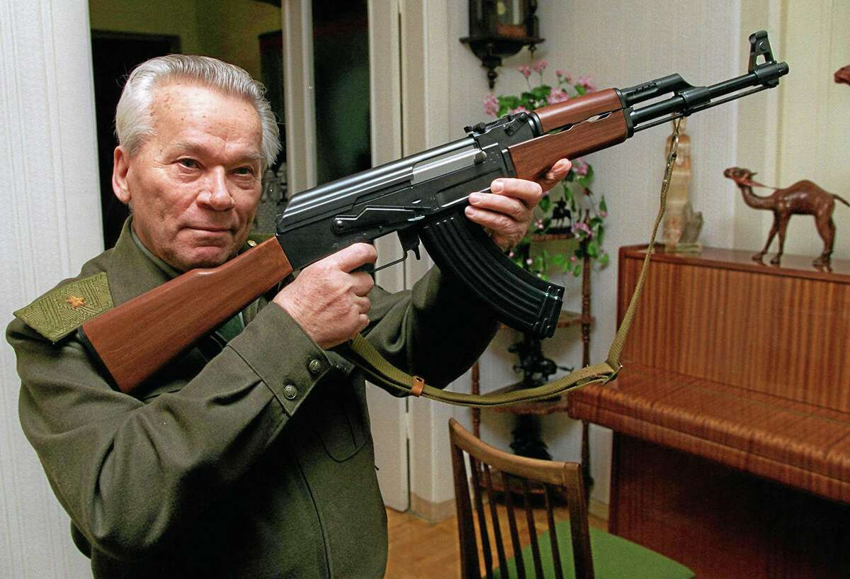 FILE- In this Wednesday, Oct. 29, 1997 file photo Mikhail Kalashnikov shows a model of his world-famous AK-47 assault rifle at home in the Ural Mountain city of Izhevsk, 1000 km (625 miles) east of Moscow, Russia. Kalashnikov, whose work as a weapons designer for the Soviet Union is immortalized in the name of the worldís most popular firearm, died Monday at the age of 94 in a hospital of the city of Izhevsk where he lived. The AK-47 has been favored by guerrillas, terrorists and the soldiers of many armies. An estimated 100 million guns are spread worldwide. (AP Photo/Vladimir Vyatkin, File)