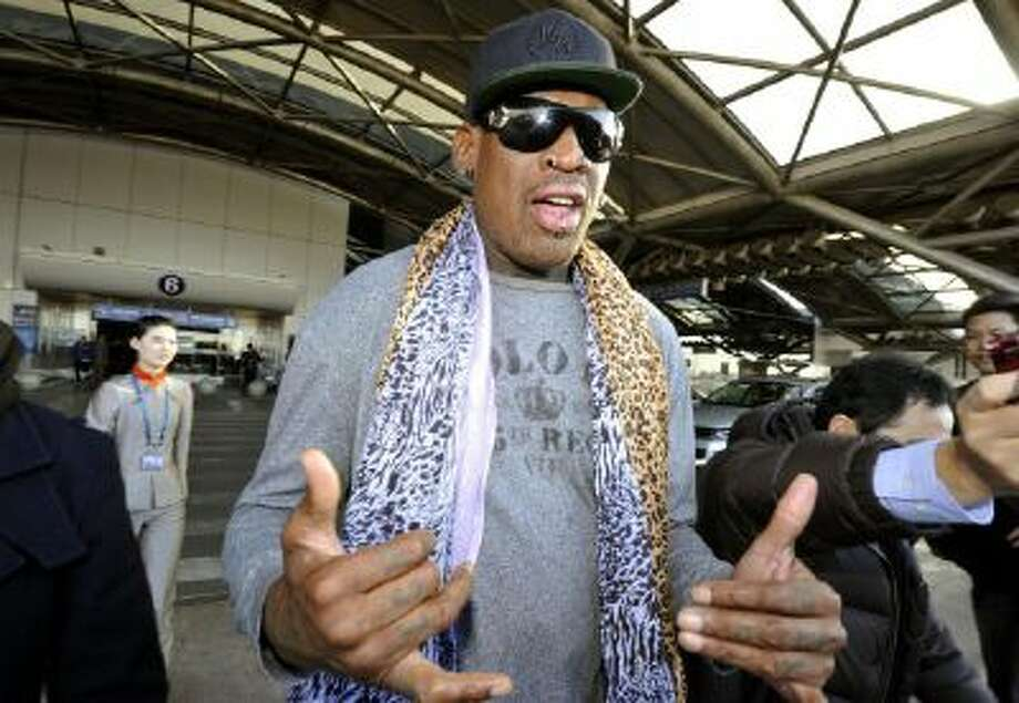 Former basketball star Dennis Rodman speaks to journalists upon arrival at the capital airport in Beijing from Pyongyang, North Korea.