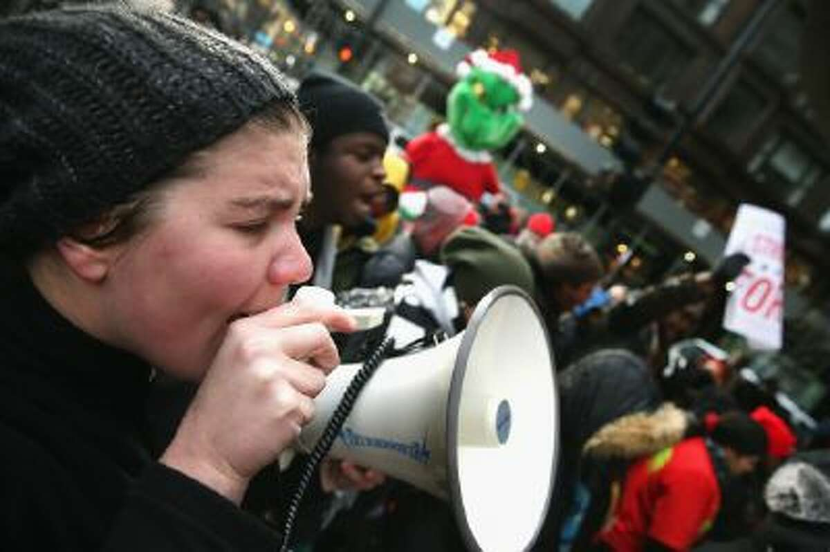Trish Kahle leads demonstrators in a chant as they protest for a pay increase for fast-food and retail workers on Dec. 5, 2013 in Chicago, Illinois.
