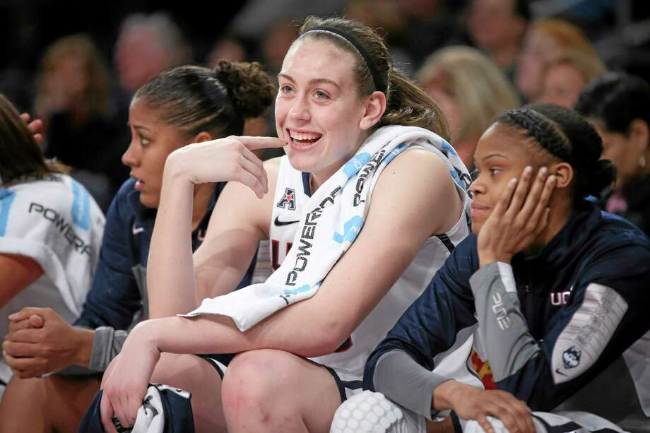 UConn forward Breanna Stewart, center, smiles on the bench during the second half of Saturday's game against California. Photo: John Minchillo — The Associated Press  / FR170537 AP