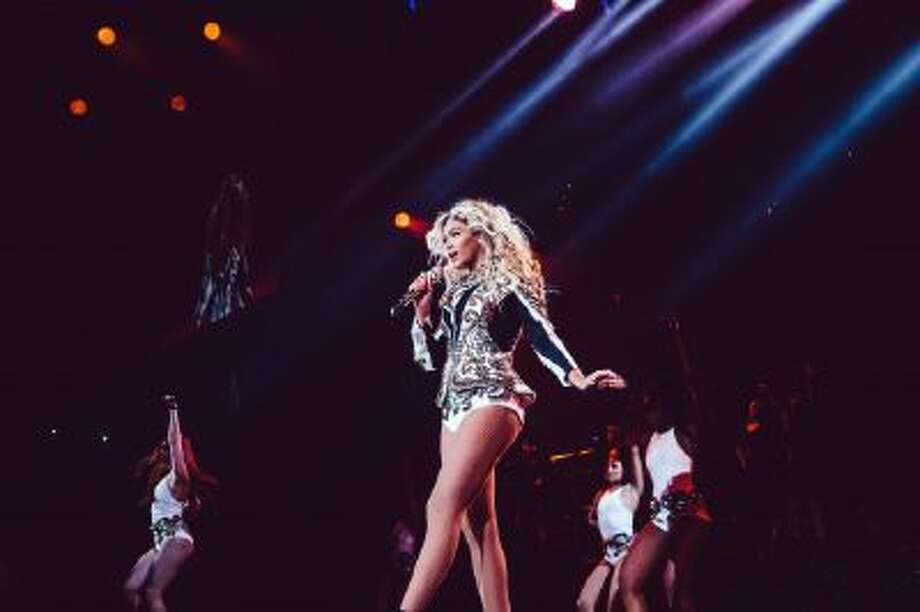 Beyonce performs onstage on her Mrs. Carter World Tour, on Friday, December 20, 2013 at the TD Garden in Boston, Mass.