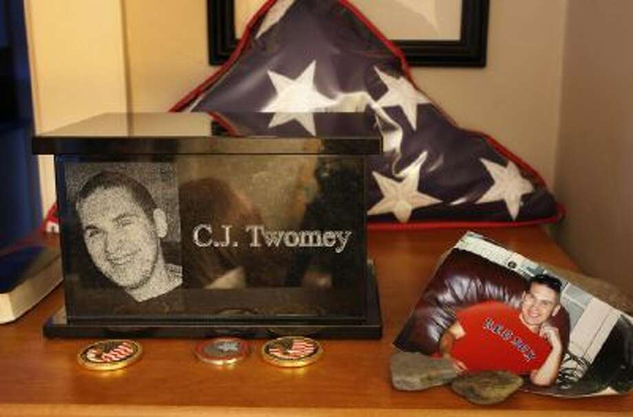 An urn containing the ashes of C.J. Twomey sits on a shelf at his parents' home in Auburn, Maine.