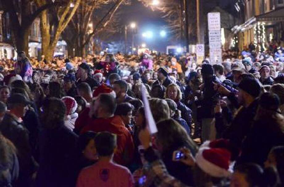 """Thousands of people came out to sing Christmas carols in front of the home of Delaney """"Laney"""" Brown, 8, who is terminally ill with a rare form of leukemia."""