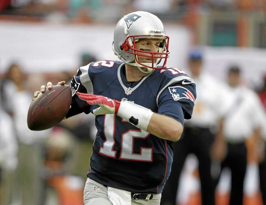 Patriots quarterback Tom Brady faces the Ravens Sunday with a chance to clinch the AFC East title. Photo: Lynne Sladky — The Associated Press  / AP