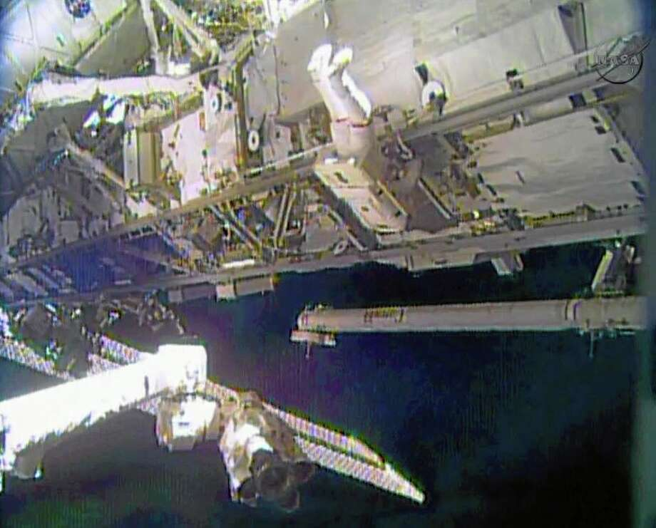 In this image made from video provided by NASA, astronaut Rick Mastracchio performs a space walk outside the International Space Station on Saturday, Dec. 21, 2013. Mastracchio and Michael Hopkins ventured out of the station to try to revive a crippled cooling line. (AP Photo/NASA) Photo: AP / NASA