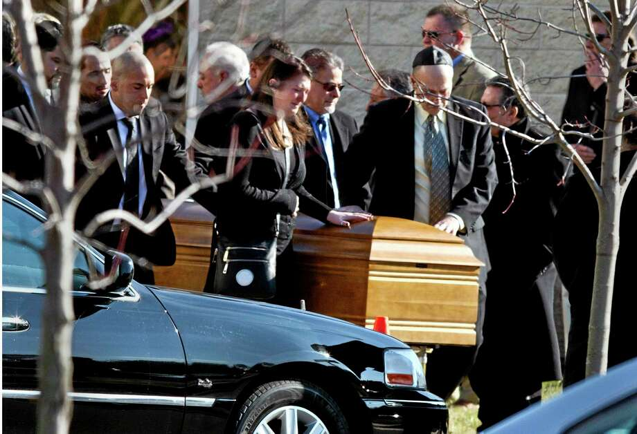 The casket of Dustin Friedland is carried from the temple after a funeral service Wednesday, Dec. 18, 2013,in Lakewood, N.J.  Friends and relatives gathered to mourn the 30-year-old lawyer who was shot to death by a carjackers outside a northern New Jersey mall last weekend. (AP Photo/The Asbury Park Press, Doug Hood)  NO SALES Photo: AP / The Asbury Park Press