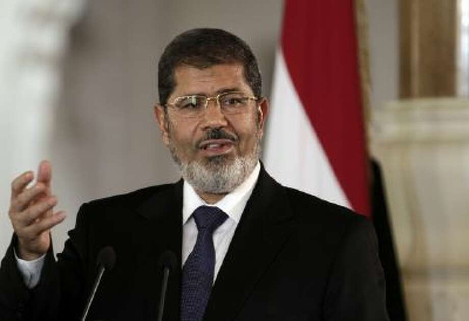 In this July 13, 2012 file photo, then Egyptian President Mohammed Morsi speaks to reporters at the presidential palace in Cairo.