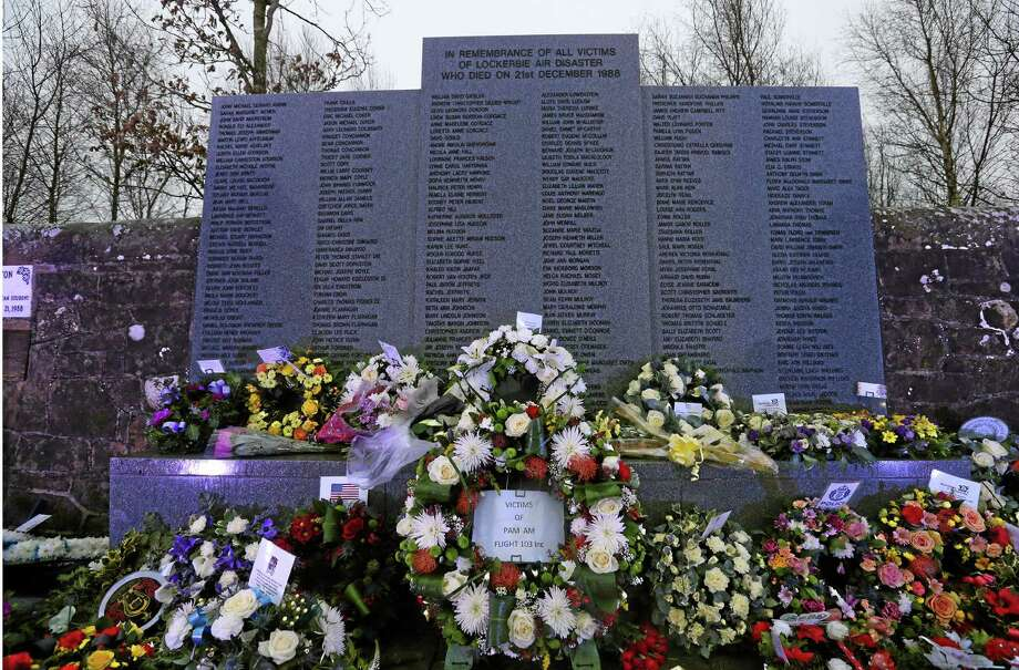 Floral tributes have been laid at the main memorial stone in memory of the victims of Pan Am flight 103 bombing, in the garden of remembrance at Dryfesdale Cemetery, near Lockerbie, Scotland. Saturday Dec. 21, 2013. Pan Am flight 103 was blown apart above the Scottish border town of Lockerbie on Dec. 21, 1988. All 269 passengers and crew on the flight and 11 people on the ground were killed in the bombing. (AP Photo/Scott Heppell). Photo: AP / AP