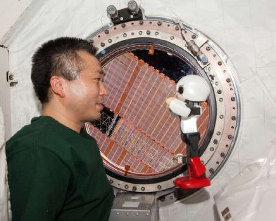 A robot, named Kirobo, and Japanese astronaut Koichi Wakata exchange small talks in Japanese at the International Space Station.