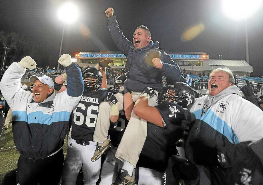 (Mara Lavitt ó New Haven Register)  December 13, 2013 Arute Field, New Britain 2013 CIAC Class S Football Championship. Ansonia 51, Woodland 12. Coach Thomas Brockett carried onto the field in celebration. Photo: Journal Register Co. / Mara Lavitt
