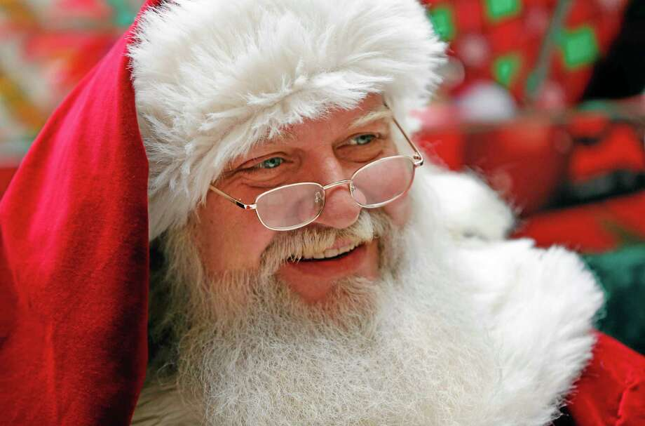 A man portraying Santa Claus sits in a mall in South Portland, Maine on Thursday, Dec. 19, 2013. Photo: Robert F. Bukaty—The Associated Press  / AP