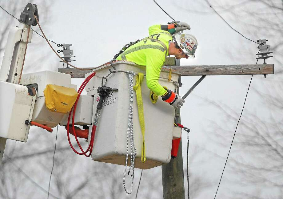 Catherine Avalone/The Middletown Press ¬ A Potelco linesman from Seattle, Washington contracted by CL&P repair a power line on Brooks Road in Middletown following Hurricane Sandy Tuesday afternoon. Photo: Journal Register Co.