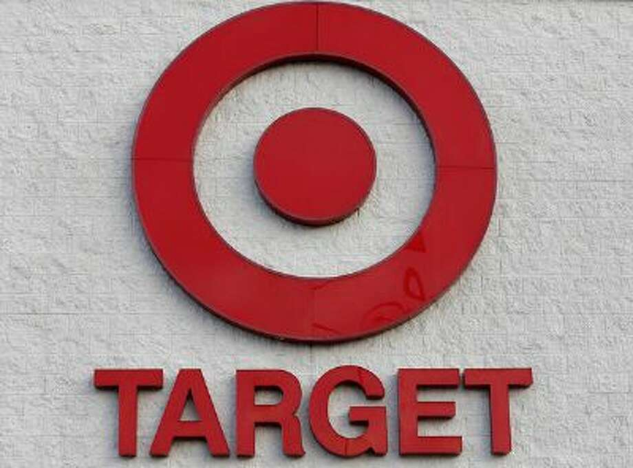 This Thursday, Dec. 19, 2013 photo shows a Target retail chain logo on the exterior of a Target store in Watertown, Mass. Target says that about 40 million credit and debit card accounts may have been affected by a data breach that occurred just as the holiday shopping season shifted into high gear. Photo: AP / AP net