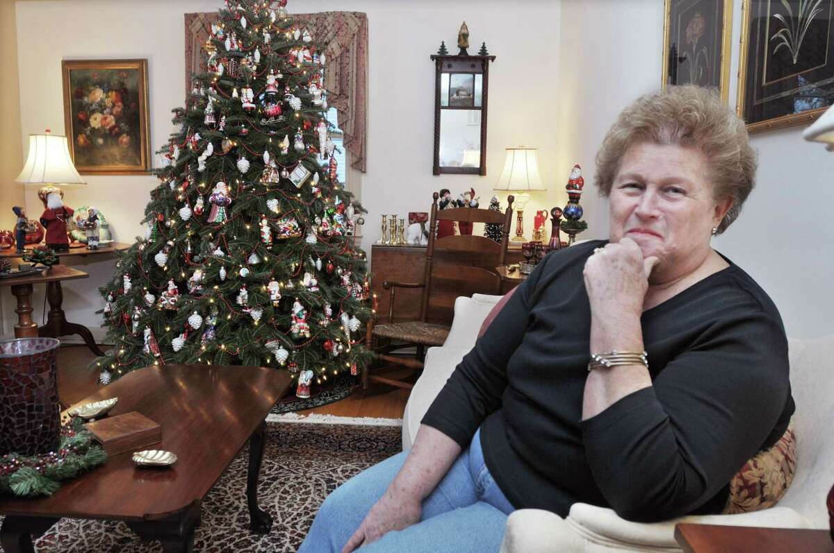 Barbara Fountain in the living room of her Cromwell home Friday afternoon with the largest of nine trees she sets up for Christmas. In two weeks, Fountain will put all the Christmas decor away.