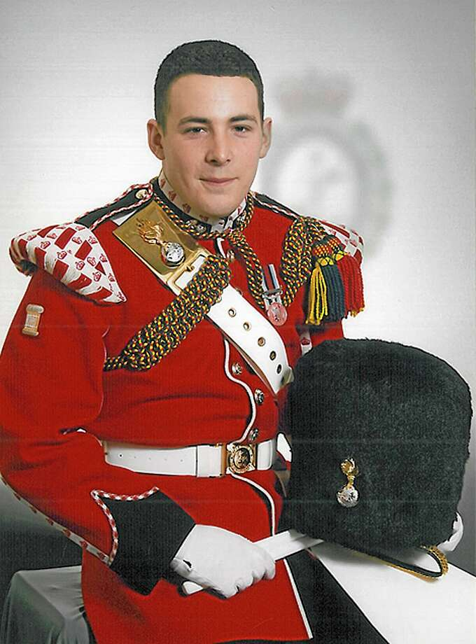 "FILE - This undated file image released on Thursday May 23, 2013 by the British Ministry of Defence, shows Lee Rigby, who was attacked and killed by two men in the Woolwich area of London. A jury on Thursday Dec. 19, 2013 convicted two British men who considered themselves ""soldiers of Allah"" of murdering a serviceman who was run down with a car and stabbed to death in a frenzied attack on a London street. They were acquitted of attempting to murder a police officer. (AP Photo/MOD, File) Photo: AP / Ministry Of Defence"