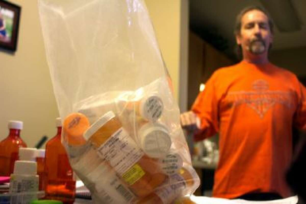 Lung transplant patient James Sawyer must take medications that cost thousands of dollars a month as a result of work-related illness.