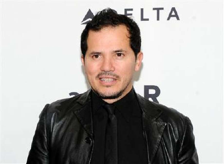 "This Feb. 6, 2013 file photo shows actor John Leguizamo at amfAR's New York gala in New York. Leguizamo lends his voice to the character Alex in the new film ""Walking with Dinosaurs."" Photo: Evan Agostini/Invision/AP / Invision"