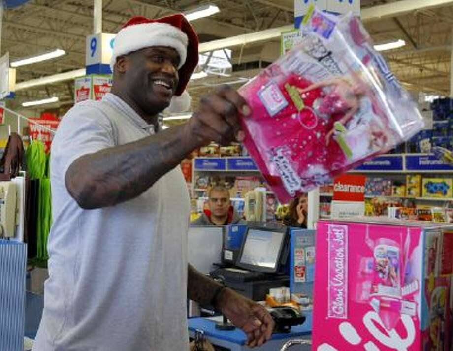 Shaquille O'Neal as Shaq-A-Claus checks out after shopping for toys for the toys for tots program providing Marines with gifts to distribute to local kids in need in Framingham, Mass. in 2010.