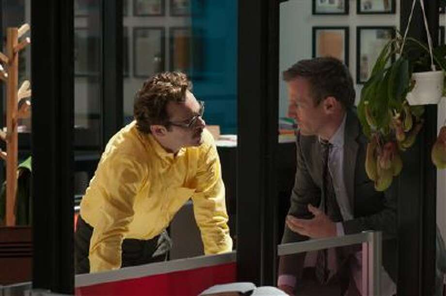 "This image released by Warner Bros. Pictures shows Joaquin Phoenix, left, and director Spike Jonze on the set of ""Her."" The film has been selected as the best film of the year by the National Board of Review and Phoenix was nominated for a Golden Globe for best actor in a motion picture musical or comedy. Photo: AP / Warner Bros. Pictures"
