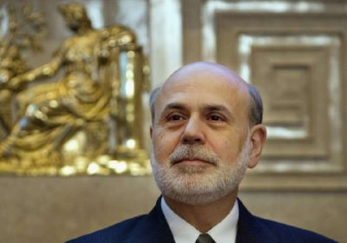 Federal Reserve Chairman Ben Bernanke attends the opening of the College Fed Challenge National Finals at the Federal Reserve Board of Governors in Washington.