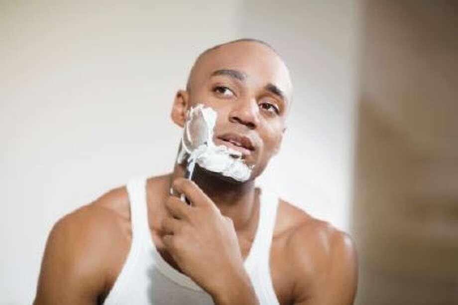 African man shaving face Photo: Getty Images/Blend Images / Blend Images