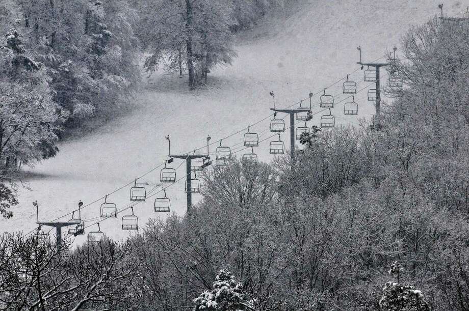 Despite the recent snowfall, the lifts remain stalled at Powder Ridge, awaiting inspections. But owner Sean Hayes remains confident the slopes will be open Friday. Photo: Catherine Avalone - The Middletown Press  / TheMiddletownPress