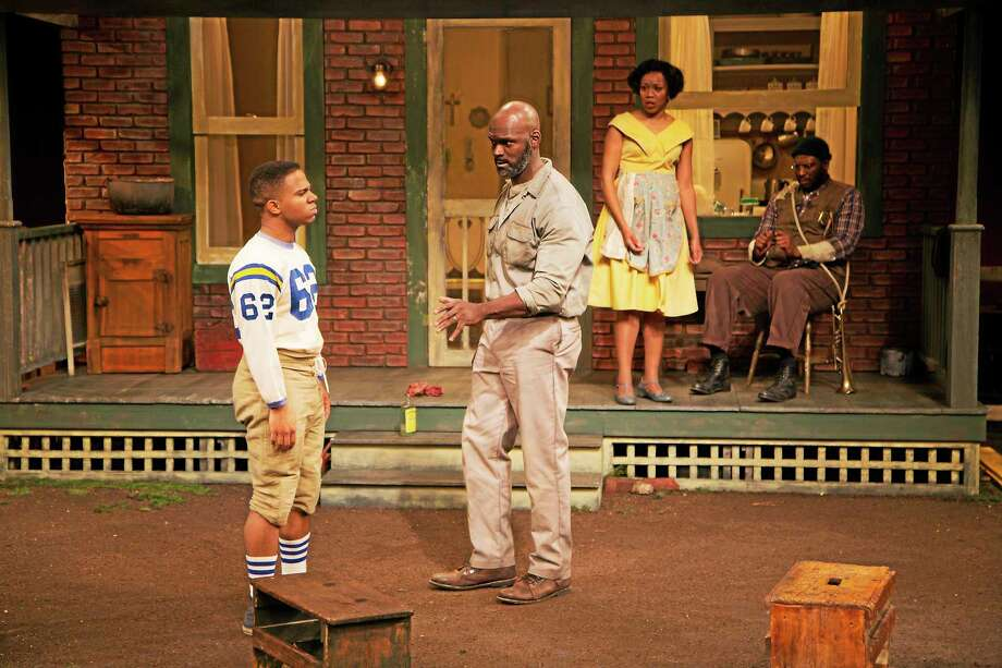 Photograph by T Charles Erickson Esau Pritchett as Troy Maxson, center, and Portia as his wife Rose, are joined by the case of Fences, a play by August Wilson. The play runs to Dec. 22 at Long Wharf Theatre, co-production with the McCarter Theatre Center, and is directed by Phylicia Rashad. Photo: Journal Register Co. / © T Charles Erickson