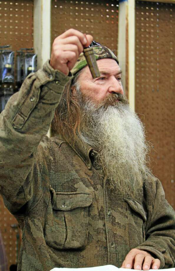 "File-This Nov. 7, 2013 file photo shows Phil Robertson, the Duck Commander, holding the 1 millionth duck call assembled for 2013 at companyís warehouse in West Monroe, La. The A&E channel says ""Duck Dynasty"" patriarch Robertson is off the show indefinitely after condemning gays as sinners in a magazine interview. In a statement Wednesday,  Dec. 18, 2013, A&E said it was extremely disappointed to read Robertson's comments in GQ magazine. (AP Photo, The News-Star/Margaret Croft)     NO SALES Photo: AP / THE NEWS-STAR"