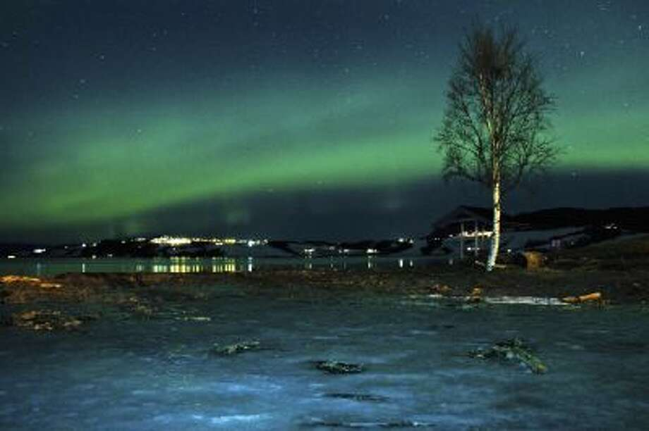The aurora borealis, or Northern Lights, are seen near the city of Trondheim, Norway Tuesday Jan. 23, 2012. Stargazers were out in force in northern Europe on Tuesday, hoping to be awed by a spectacular showing of northern lights after the most powerful solar storm in six years.