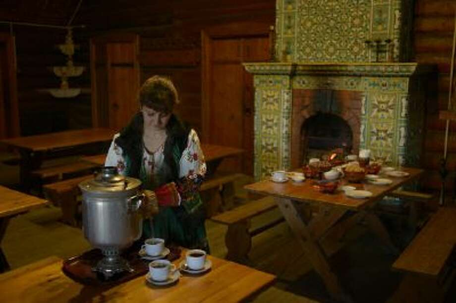 A waitress sets the table at a tea house in Dagomys, Sochi, Russia, on Nov. 21. Although vodka gets more publicity, tea is the best-selling drink in the country.