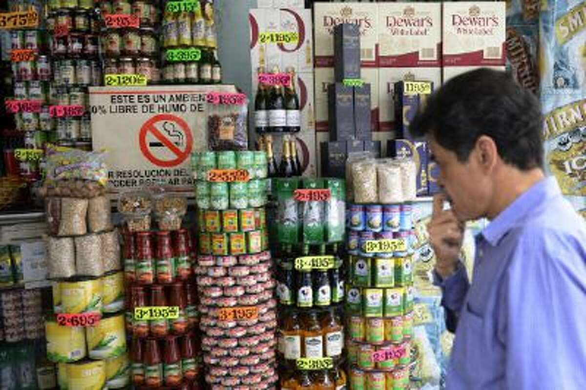 A man looks at the goods prices in a private market in Caracas, Venezuela, on August 22.