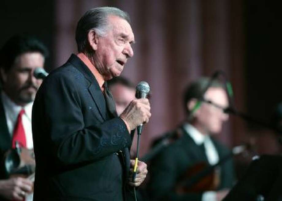 In a Jan. 7, 2011 photo, Country Music Hall of Fame member and Grammy Award winner Ray Price celebrates his 86th birthday by performing in Bullard Texas.Dr.