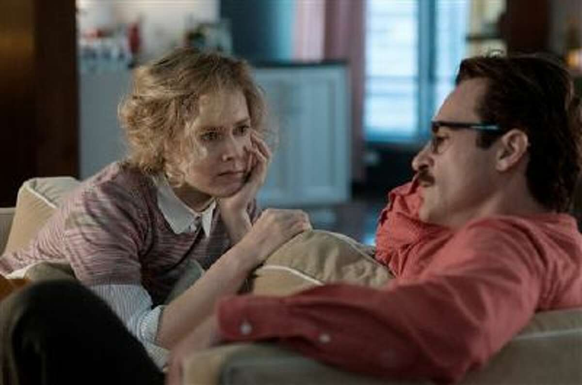 This image released by Warner Bros. Pictures shows Amy Adams, left, and Joaquin Phoenix in a scene from
