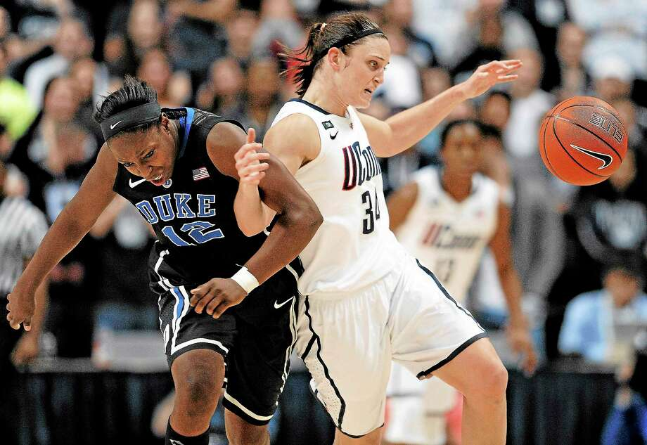 Duke's Chelsea Gray, left, and UConn's Kelly Faris tangle during the Huskies' 79-49 win during the two teams' last meeting in January. Photo: Jessica Hill — The Associated Press File Photo  / A2013