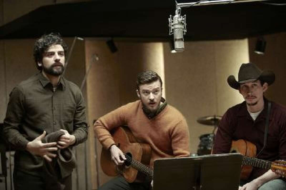 This film image released by CBS FIlms shows, from left, Oscar Isaac, Justin Timberlake and Adam Driver in a scene from