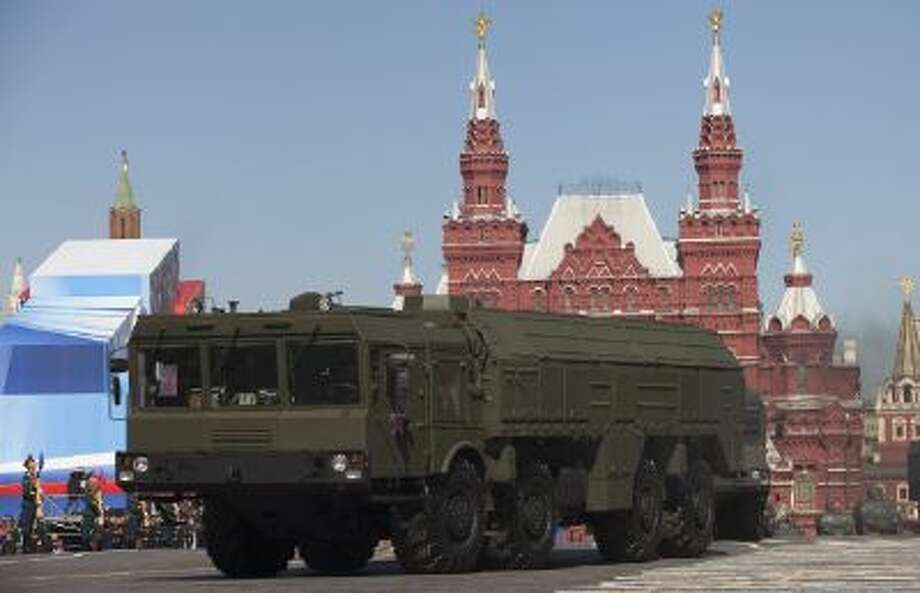 Short-range missiles move through Red Square in Moscow.