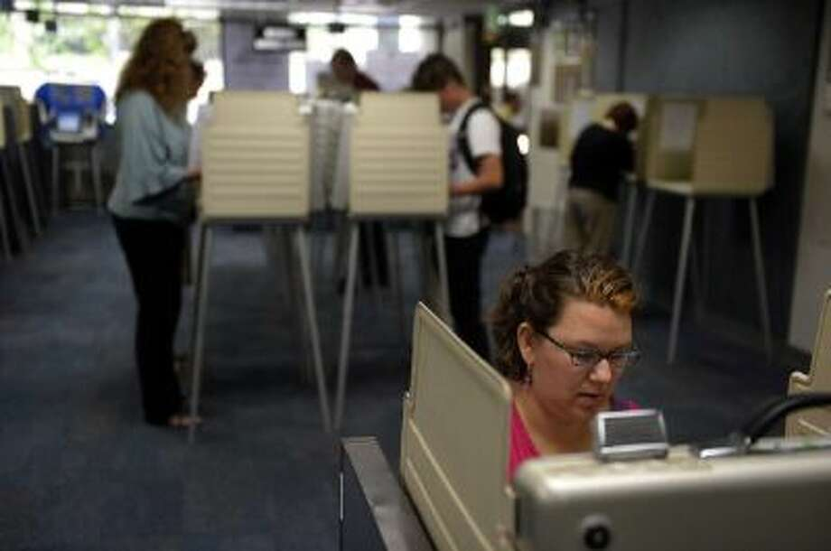 Voters in Colorado Springs cast ballots in September. There's a movement underway to dramatically reform primaries in that state and across the nation. Photo: Denver Post Via Getty Images / Copyright - 2013 The Denver Post, MediaNews Group.