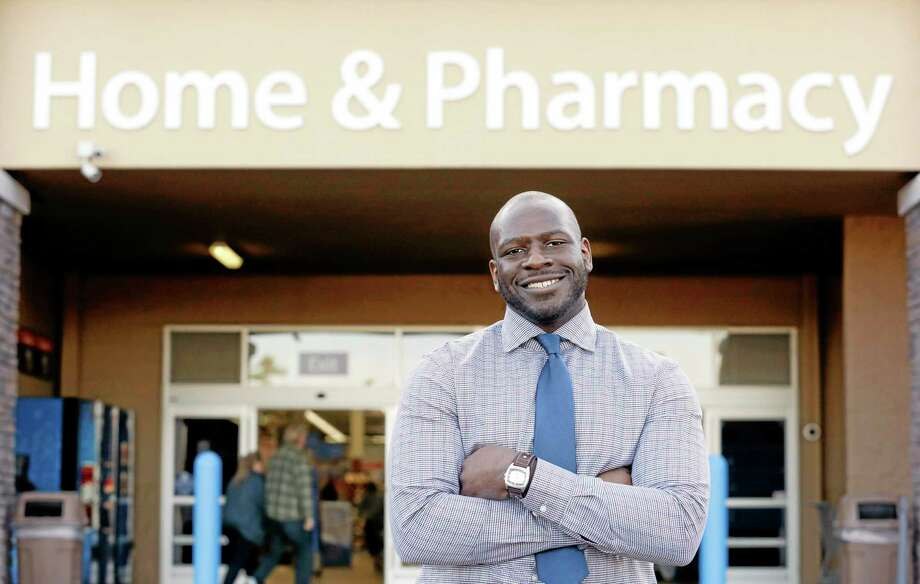 """This photo taken Nov. 21, 2013 shows James Lott outside the Wal-Mart store where he works as a pharmacist in Bonney Lake, Wash. Lott, who lives in Renton, Wash., a suburb of Seattle, adds significantly to his six-figure job salary by day-trading stocks. It's not just the wealthiest 1 percent: Fully 20 percent of U.S. adults become rich for parts of their lives, wielding outsized influence on America's economy and politics. And this little-known group may pose the biggest barrier to reducing the nation's income inequality. While the growing numbers of the U.S. poor have been well documented, survey data provided exclusively to The Associated Press detail the flip side of the record income gap: the rise of the """"new rich."""" Photo: Elaine Thompson—The Associated Press  / AP"""