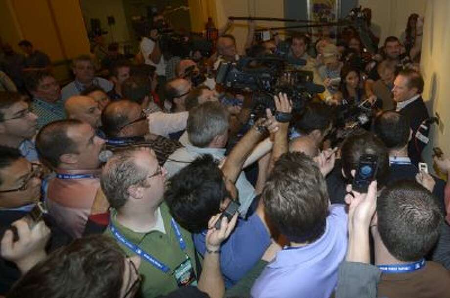 While reporters swarm agent Scott Boras (right), an 18-year-old was able to get all the breaking news.