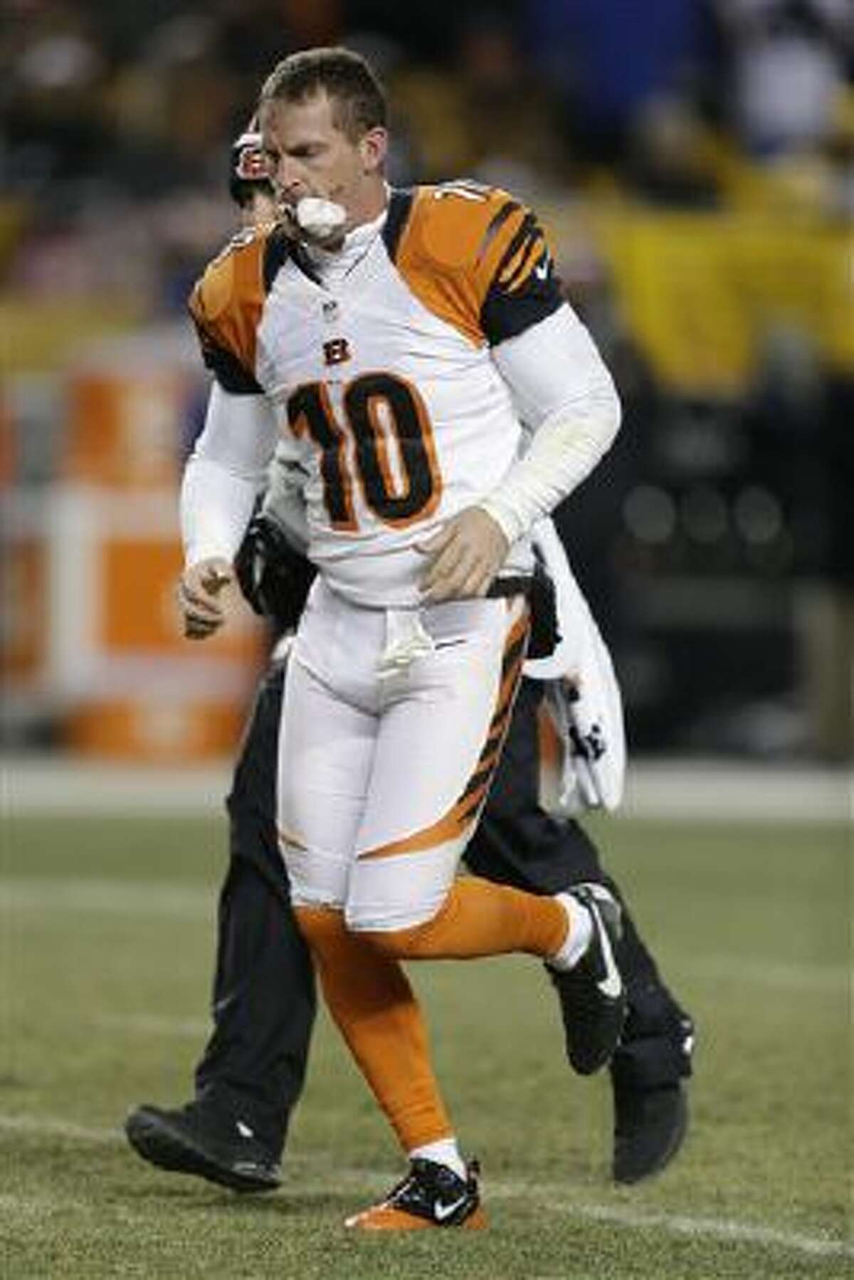 Cincinnati Bengals punter Kevin Huber (10) is taken from the field after being injured in the first half of an NFL football game between the Pittsburgh Steelers and the Cincinnati Bengals on Sunday, Dec. 15, 2013 in Pittsburgh.