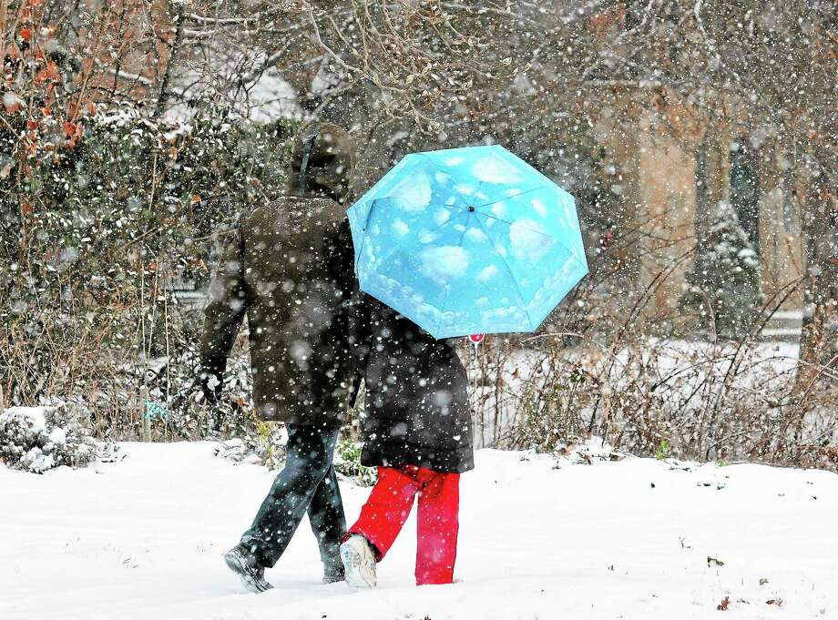 A couple walks along Edgewood Avenue in New Haven during Saturday's snowstorm. Peter Casolino — New Haven Register Photo: Journal Register Co.